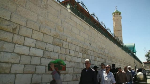 Palestinian worshippers prayed in a street outside Jerusalems Old City on the last Friday of the Muslim holy month of Ramadan after Israeli...