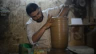 A Palestinian youth works at a pottery workshop at the oldest pottery workshop in Gaza City 09 September 2017 Pottery is an ancient and traditional...