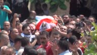 Palestinians carry the dead body of 17yearold Palestinian Qutayba Ziad Zahran who was allegedly attempted a stabbing attack and killed by Israeli...