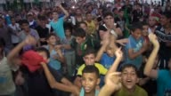 Palestinians celebrate the ceasefire between Palestinian resistance factions and Israel in Rafah Khan Yunis and Nablus cities on August 26 2014 An...