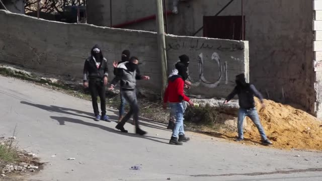 Palestinians clash with Israeli security forces following the funeral ceremony of Halid AlHalil who was killed by Israeli soldiers in Hebron West...