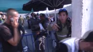 Palestinians cross into Jerusalem through the Kalandia border crossing which divides the city from Ramallah in West Bank on July 13 2015 Thousands of...