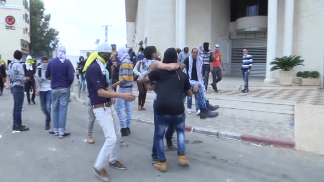 Palestinians gathered at the Beit El area clash with the Israeli forces during a protest against the Israeli violations in Ramallah West Bank on...