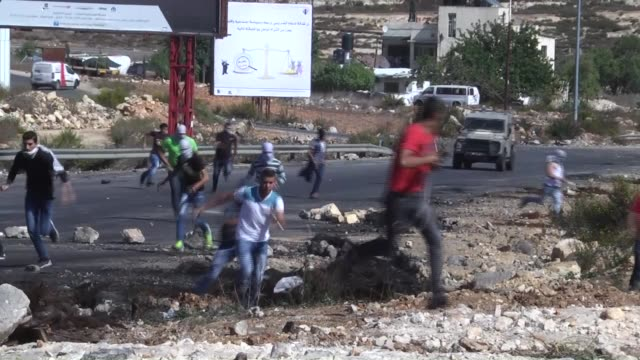 Palestinians gathered at the Huwwara checkpoint clash with Israeli soldiers during a protest against the Israeli violations in Nablus West Bank on...