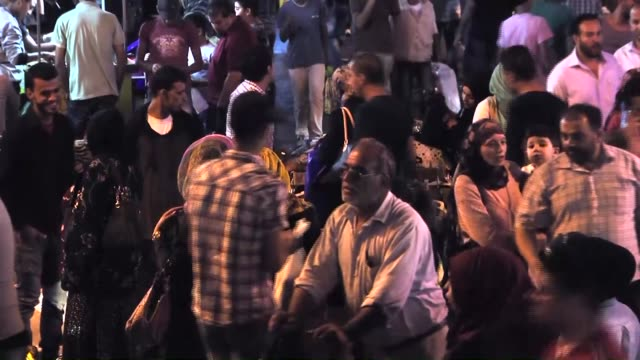 Palestinians go shopping ahead of the 'Eid alFitr' also known as 'Ramadan Holiday' as holy month of Ramadan will be finished on 16th of July 2015 in...