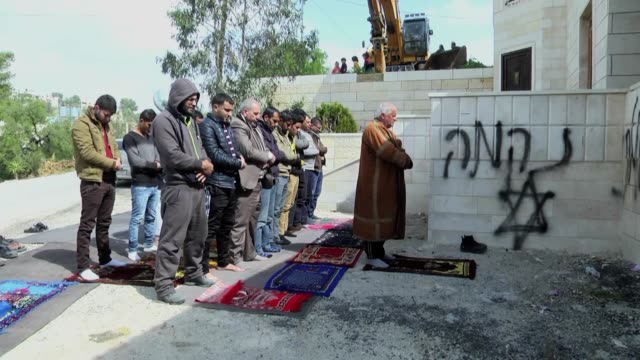 Palestinians inspect the Al Huda Mosque 'allegedly' torched by Jewish settlers in Bethlehem's AlJabaa Village West Bank on February 25 2015 The...