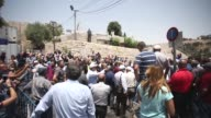 Palestinians packed the narrow alleyways leading to Jerusalem's Al Aqsa mosque on Monday as hundreds prayed at the threshold refusing to enter for a...