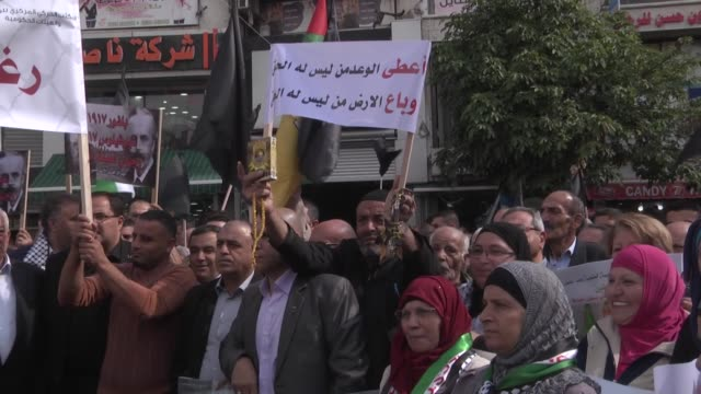 Palestinians participate in a march on November 02 in the centre of the West Bank city of Ramallah to protest the 100th anniversary of Britain's...