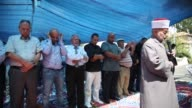 Palestinians perform Firday Prayer led by Grand Mufti of Jerusalem Sheikh Muhammad Hussein in front of the house of Shamasneh family who have been...