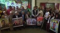 Palestinians stage a demonstration in solidarity with Israeliheld Palestinian prisoners who are on hunger strike to protest their prison conditions...