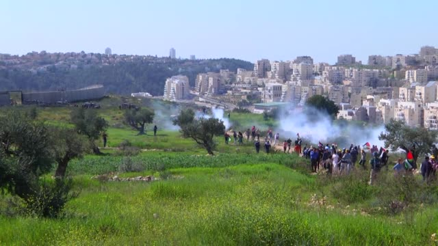 Palestinians stage a protest against the separation wall after the Friday prayers in the town of Belin in the city of Ramallah on the West Bank on...