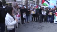 Palestinians stage a protest in support of Palestinian journalist Mohammed alQeq who has been on a 79day hunger strike to protest his sixmonth...