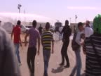Palestinians throw stones at water cannon during a clash with Israelis