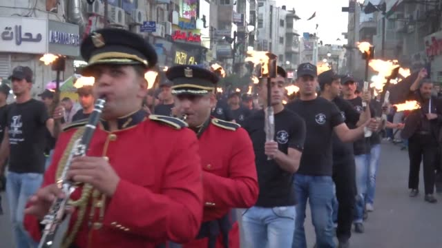 Palestinians took part in a commemoration march on the eve of the 66th anniversary of the Nakba in the city of RAmallah in the West Bank