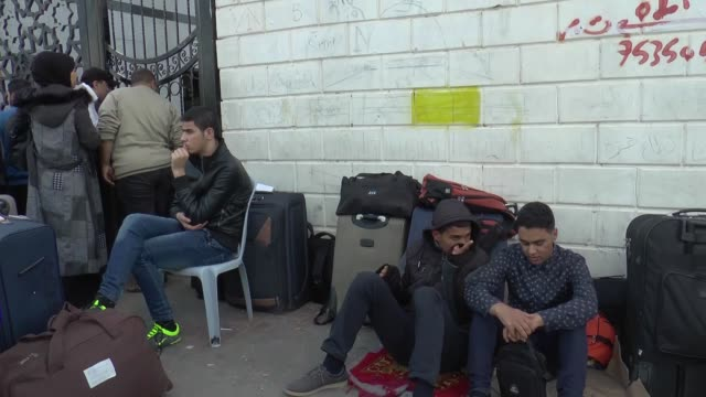 Palestinians wait for passport control at the Rafah border gate after Rafah crossing opens for 3 days under Palestinian Authority for 1st time in 10...
