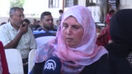 Palestinians wait for the passport check at the Palestinian side of Rafah border crossing on August 17 to enter Egypt after Egyptian authorities on...