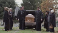 pallbearers carrying coffin