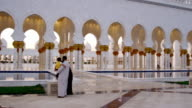 Pan across Sheik Zayed Grand Mosque, Abu Dhabi, at golden hour