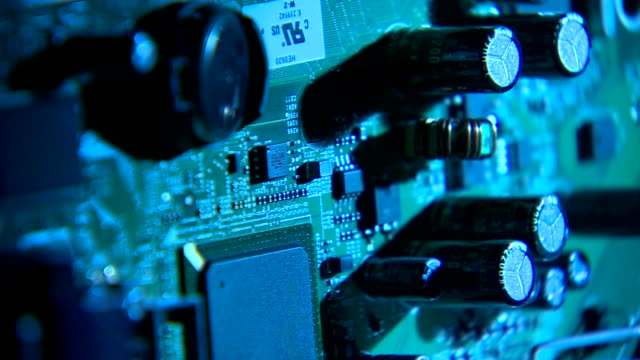 Pan across the components on a circuit board.