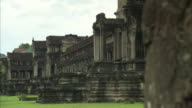 Pan across the exterior of the Angkor Wat temple complex in Cambodia.