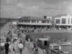 Pan across the exterior of the casino and a boating lake on Canvey Island 1953