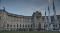 Pan across the exterior of the Hofburg Palace in Vienna.