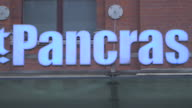 Pan across the sign for St Pancras International station, London.
