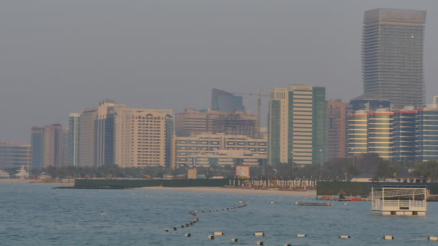Pan across to the Corniche from 18th Street to Marina Mall, Abu Dhabi, United Arab Emirates, Middle East, Asia