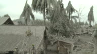 Pan across village and river devastated by heavy volcanic Ashfall from Merapi volcano; Indonesia. 7 November 2010 / AUDIO