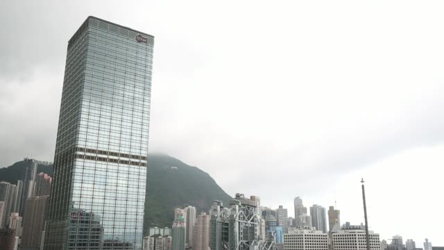 Pan down from cloudy sky to Central Plaza right in Wan Chai Norths business district of Hong Kong China on Thursday May 14 Pan from Cheung Kong...