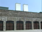 / pan exterior stone walls near entrance with guard tower