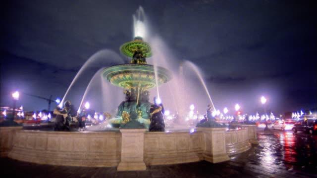 Pan fountain and traffic at Place de la Concorde / Paris, France