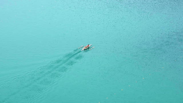 HD LR Pan: Four-seated scull rowing team practicing