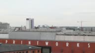 Pan L R city skyline view and building rooftops including The Printworks entertainment venue in Manchester UK on Wednesday July 2 High angle view...
