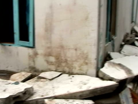 MS pan left across damage to houses caused by tsunami, Maldives