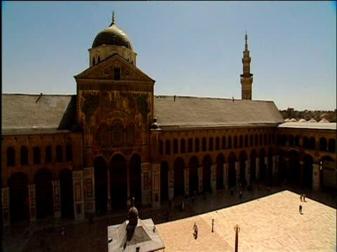 Pan left across eighth century Great Mosque of Damascus