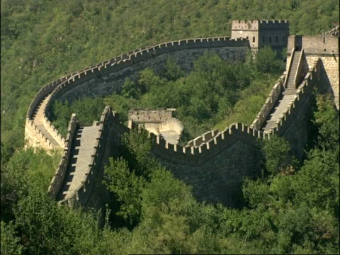 Pan left across from section of Great Wall of China to watchtower, Mutianyu, China