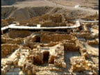 Pan left across ruins of Qumran settlement adjacent to finding place of Dead Sea Scrolls on fringes of Dead Sea West Bank