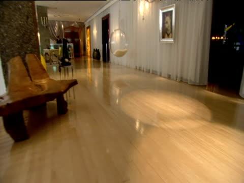 Pan left across stylish lobby at Sanderson Hotel London