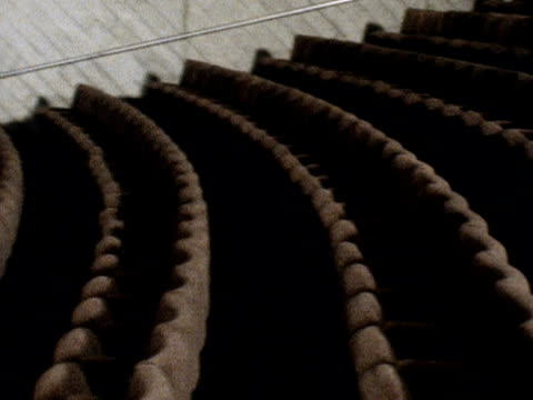 Pan left across the seating area to the stage of the Lyttleton Theatre in the new National Theatre building March 1976