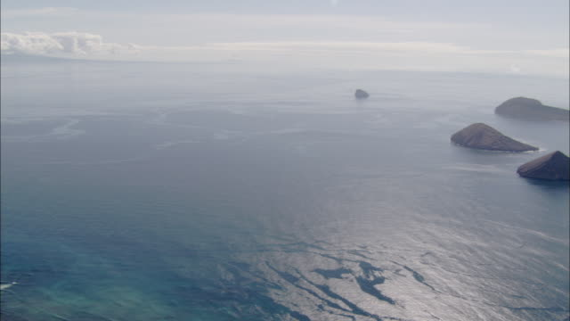 Pan left from little islands to Isabela Galapagos Islands Available in HD.