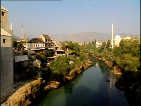 Pan left from Neretva River to Mostar Bridge