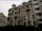 Pan left from old run down Art Deco apartment block to modern Art Deco apartment block Casablanca