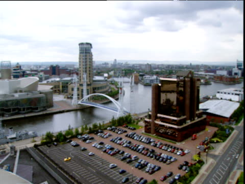 Pan left over Daniel Libeskind's Imperial War Museum North in Manchester with James Stirling and Michael Wilford's Lowry Centre in background Salford