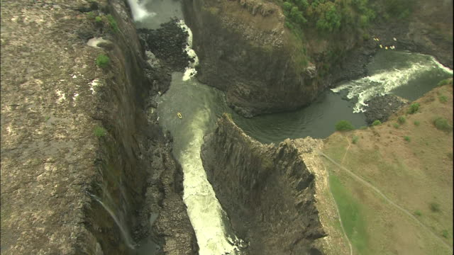 Pan left over fork in river at Victoria Falls, Aerial Shot