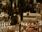 Pan left over houses on hillside Alhambra
