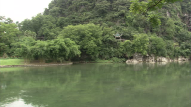 Pan left over Li River to Flower Bridge in Seven Stars Park