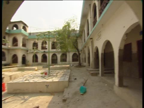 Pan left over the Red Mosque's courtyard after the attacks of July 2007
