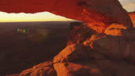 Pan left, sun rises in Arches National Park