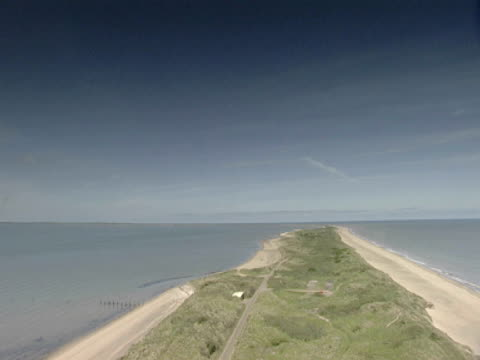 GV, WS of pan left to right, peninsula, blue sea, sky, calm, relaxation. Spurn Point, England, UK